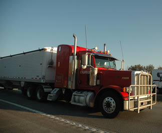 red-big-rig-driving-freeway