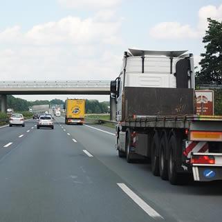 truck-driving-under-freeway
