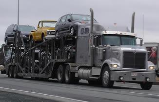 truck-hauling-cars