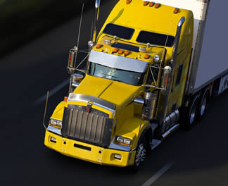 yellow-big-rig-truck-driving-on-highway