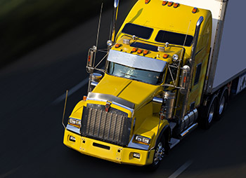 speed yellow semi-truck on highway